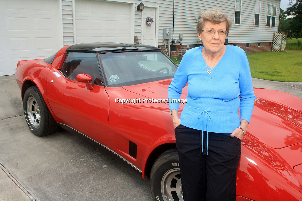 "Hedwig 'Sue' Bischoff poses for a portrait in front of her 1979 Corvette at her home in New Bern, N.C. on Monday August 19, 2013. Bischoff refers to the car as her ""toy"" and is an active member of the local Twin Rivers Corvette Club. Bischoff had a posterior retroperitoneoscopic adrenalectomy, a new minimally invasive adrenal gland surgery performed at Duke University Hospital and has experienced a quicker-than-normal recuperation.  (Photo By: Jason A. Frizzelle)"