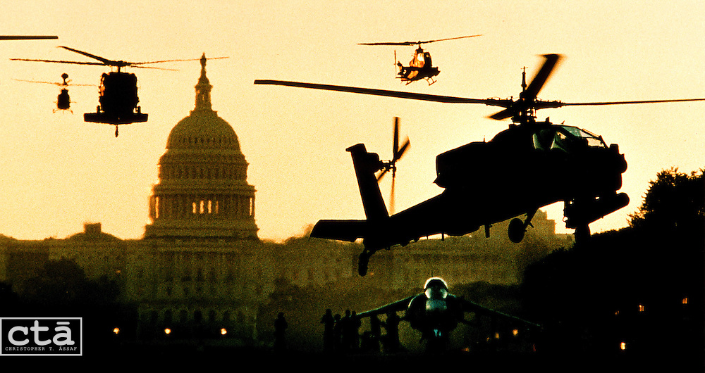 In the early morning light, U.S. Army helicopters pass the Capitol for a landing on the Mall. The military choppers were flown in for static display during the National Victory Celebration.