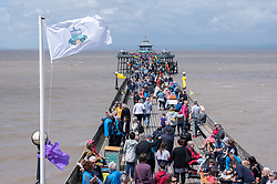 "© Licensed to London News Pictures. 27/05/2019. Clevedon, North Somerset, UK. Clevedon Pier's 150th anniversary event. 2019 marks the 150th Anniversary of the opening of Clevedon Pier, an iconic Victorian structure and Grade 1 listed pier that attracts over 100,000 visitors per year. It was called ""The most beautiful pier in England"" by poet Sir John Betjeman. Photo credit: Simon Chapman/LNP."