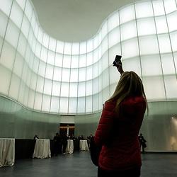 Anteprima del nuovo Museo delle Culture - MUDEC a Milano <br /> Foto Piero Cruciatti / LaPresse<br /> 26-03-2015 Milano, Italia<br /> Cultura<br /> Una visitatrice fotografa con il cellulare la struttura architettonica del nuovo museo<br /> <br /> Preview of the new Museo delle Culture - MUDEC in Milano<br /> Photo Piero Cruciatti / LaPresse<br /> 26-03-2015 Milan, Italy<br /> Culture<br /> A visitor takes a picture of the architecture of the new museum