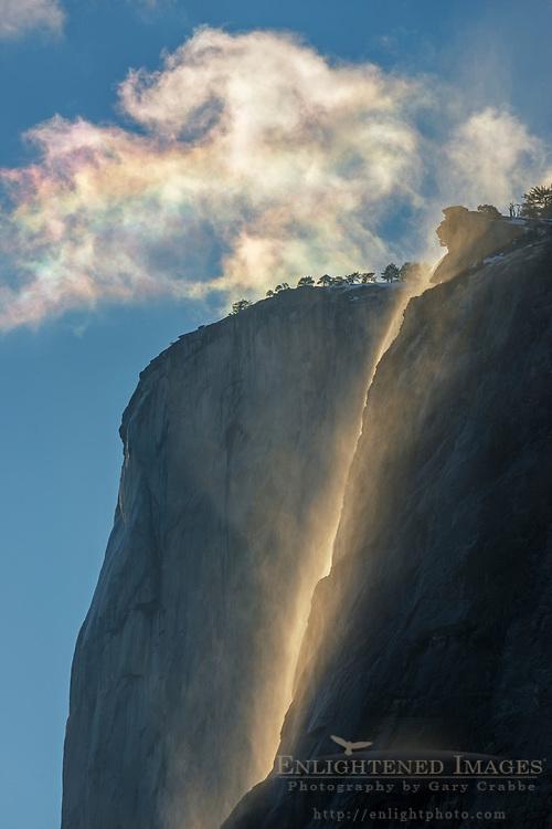 Irridescene in cloud above Horsetail Fall and El Capitan, Yosemite Valley, Yosemite National Park, California