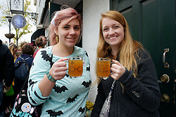Outside McNally's Tavern Kaihly Brouhard of New Jersey and Kathrine Gallager of Pittsburg, PA hold up their Butter Beers. (Bastiaan Slabbers/for PhillyVoice)
