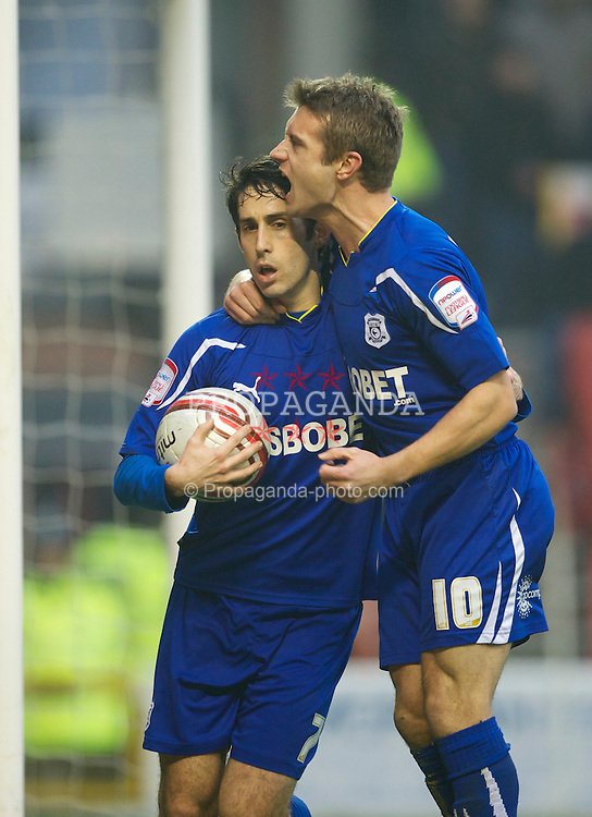 NOTTINGHAM, ENGLAND - Saturday, February 19, 2011: Cardiff City's Peter Whittingham celebrates with Stephen McPhail after scoring the first equalising goal against Nottingham Forest from the penalty spot during the Football League Championship match at the City Ground. (Photo by David Rawcliffe/Propaganda)