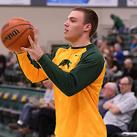 1st year forward Carter Millar (13) of the Regina Cougars warms up the home opener  on November  4 at Centre for Kinesiology, Health and Sport. Credit: /Arthur Images