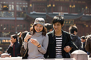Couple walking in Yu Garden Bazaar Market, Shanghai, China