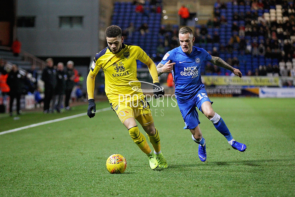 Peterborough United midfielder Joe Ward (15)  and Oxford United's Marcus Browne (10) during the EFL Sky Bet League 1 match between Peterborough United and Oxford United at London Road, Peterborough, England on 8 December 2018.