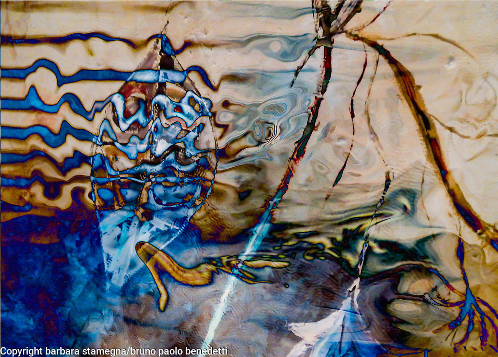 water dream abstraction image with fluid shapes, lines, waves and colors in blue and light brown tones