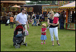 Peter and Autumn Phillips at the fairground  with her children Isla and <br /> Savannah (middle) at the Windsor Horse Show. Windsor, United Kingdom. Saturday, 17th May 2014. Picture by Andrew Parsons / i-Images
