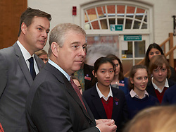 HRH The Duke of York, Patron of the Peter Jones Foundation, with Peter Jones,visits Queen Anne's School in Caversham, Reading,Berkshire, where he met 70 budding entrepreneurs taking part in the Tycoon in Schools enterprise competition.   Thursday, 5th December 2013. Picture by i-Images