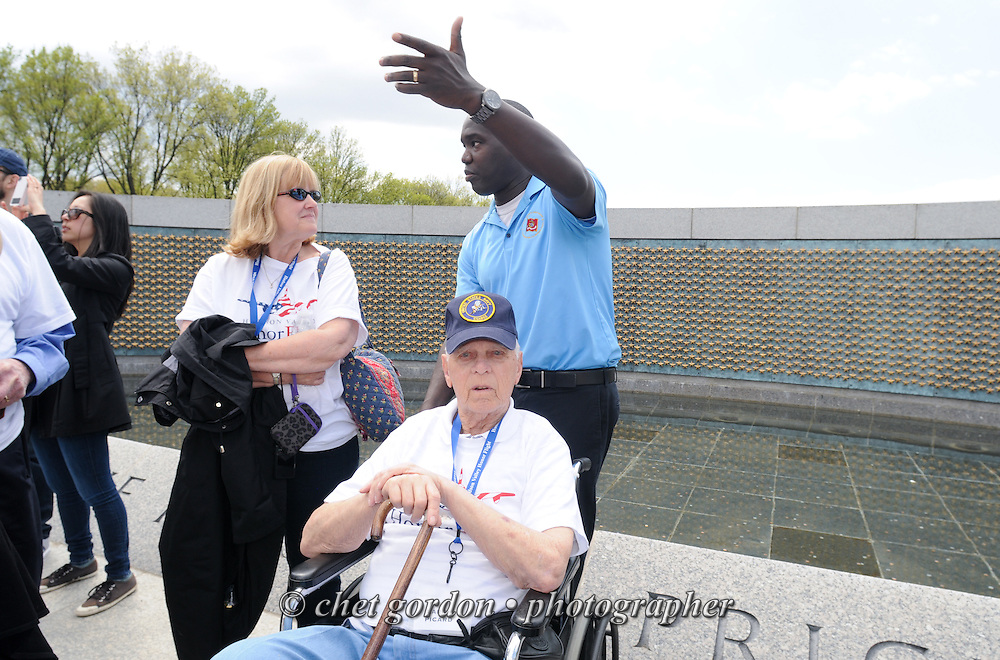 WWII Veterans and their escorts at the WWII Memorial in Washington, DC on Saturday, April 26, 2014. One Hundred WWII Veterans and their escorts from the Hudson Valley region of New York toured the WWII Memorial and Arlington National Cemetery in Arlington, VA.  © www.chetgordon.com