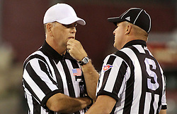 25 October 2014: Referee Greg Sujack discusses a flag with Side Judge Pat Brown during an NCAA Missouri Valley Conference game between the Missouri State Bears and the Illinois State Redbirds at Hancock Stadium in Normal, Illinois.