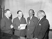 """10/03/1959<br /> 03/10/1959<br /> 10 March 1959<br /> C.C. Wakefield (Castrol) lecture. At a lecture on """"Lubricants for Road Transport"""" given by Mr. S.E. Holmes, A.R.I.C., A.F.I.N.S.P., (2nd left) of C.C. Wakefield, London, to members of the Institute of Motor Industry at Bolton Street Technical School, Dublin. Also in the picture are (l-r): Mr. G.V. Collins, Director C.C. Wakefield; Mr. Kevin Kenna, Chairman of the Institute and Mr. J.L. Fox, Instructor in Motor Engineering, Ringsend Technical School."""