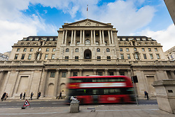 A red London Bus passes the Bank Of England as European markets follow US and Asian markets lower on Tuesday as investors continued to dump shares. London, February 06 2018.