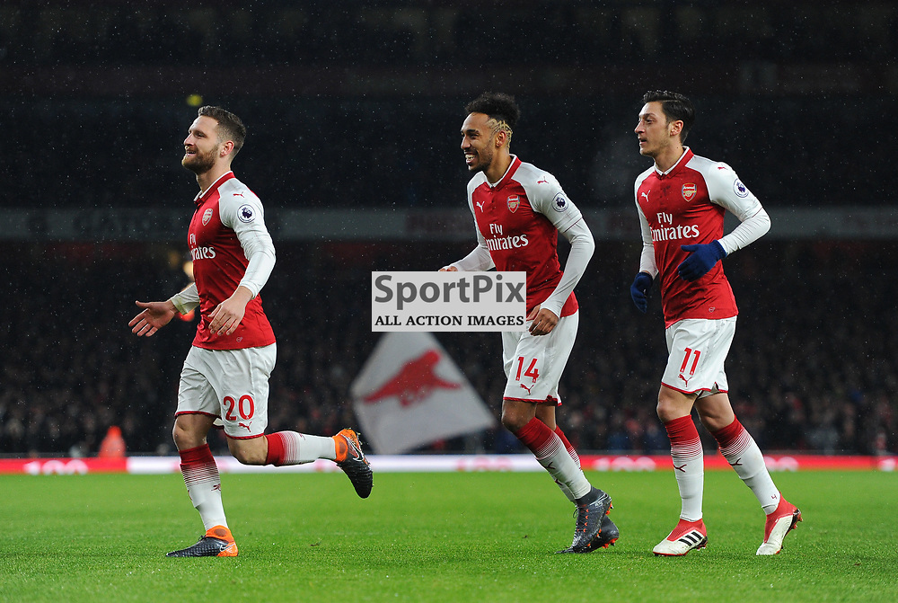 Shkodran Mustafi, Pierre-Emerick Aubameyang and Mesut Özil of Arsenal celebrate after their sides first goal during Arsenal vs Everton, Premier League, 03.02.18 (c) Harriet Lander | SportPix.org.uk