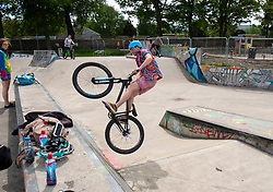 Man on bicycle doing stunts in Saughton Skatepark in Edinburgh, Scotland, United Kingdom, UK
