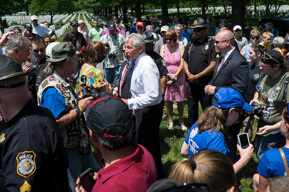 On Memorial Day, Secretary of Defense, Chuck Hagel vistis with friends and family members of fallen servicemen and women at Arlington National Cemetery in Arlington, Virginia, USA, on 26 May 2014.