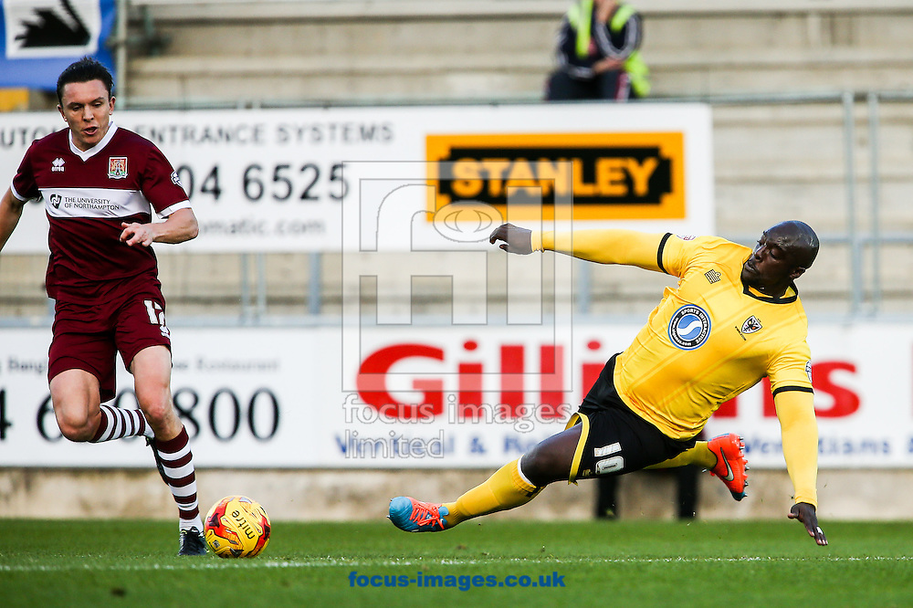 Adebayo Akinfenwa of AFC Wimbledon (right) dives in to tackle Gregor Robertson of Northampton Town (left) during the Sky Bet League 2 match at Sixfields Stadium, Northampton<br /> Picture by Andy Kearns/Focus Images Ltd 0781 864 4264<br /> 01/11/2014