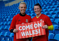 CARDIFF, WALES - Thursday, November 23, 2017: Wales' captain Sophie Ingle and Helen Ward, with free 'Come on Wales!' clapper fans which will be given out to supporters before the game, pictured a training session ahead of the FIFA Women's World Cup 2019 Qualifying Round Group 1 match between Wales and Kazakhstan at the Cardiff City Stadium. (Pic by David Rawcliffe/Propaganda)