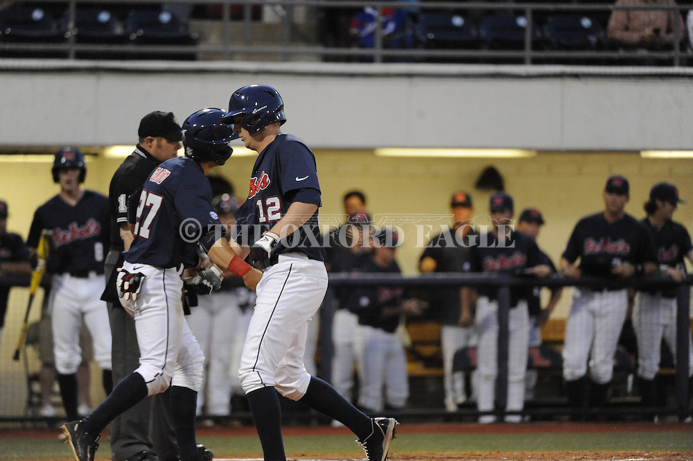 Ole Miss's Connor Cloyd (27) and J.B. Woodman (12) celebrate a two-run home run by Woodman against Central Arkansas in college baseball action on Tuesday, April 21, 2015.