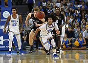Nov 6, 2019; Los Angeles, CA, USA; UCLA Bruins guard Tyger Campbell (10) and Long Beach State 49ers forward Romelle Mansel (13) pursue the ball in the first half  at Pauley Pavilion. UCLA defeated Long Beach State 69-65.