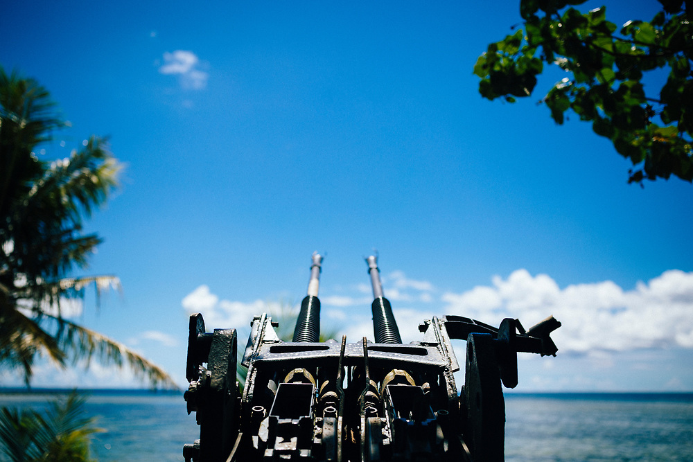 An anti-aircraft gun--a relic of WWII--pointed toward the ocean on Guam island.