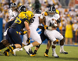 Sep 5, 2015; Morgantown, WV, USA; Georgia Southern Eagles running back LA Ramsby is stopped in the backfield by many West Virginia Mountaineers during the second quarter at Milan Puskar Stadium. Mandatory Credit: Ben Queen-USA TODAY Sports