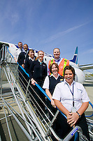 West jet employees gather together for a portrait at the Comox airport. (YQQ)  Comox, Vancouver Island, British Columbia, Canada.
