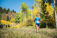 Competitors race in the annual Golden Leaf Half Marathon in Aspen, Colorado.