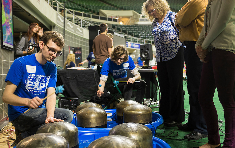 Senior music majors Turner Matthews, left, and Jake Schlaerth demonstrate the homemade musical instrument they created for onlookers during the Ohio University Student Expo on Thursday, April 10, 2015.   Photo by Ohio University / Rob Hardin