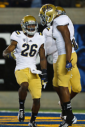 BERKELEY, CA - OCTOBER 06: Safety Andrew Abbott #26 of the UCLA Bruins celebrates after intercepting a pass against the California Golden Bears during the first quarter at California Memorial Stadium on October 6, 2012 in Berkeley, California. The California Golden Bears defeated the UCLA Bruins 43-17. (Photo by Jason O. Watson/Getty Images) *** Local Caption *** Andrew Abbott