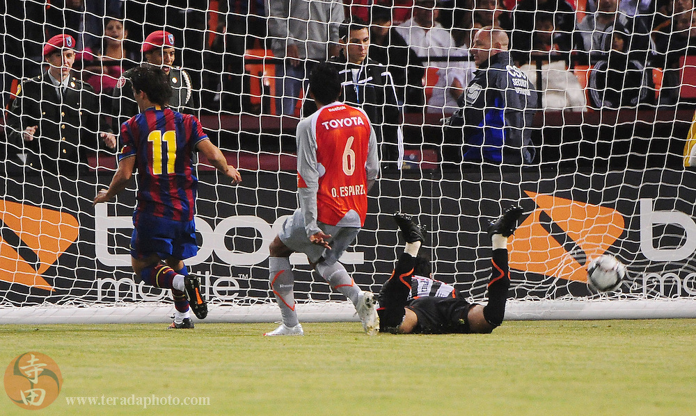 August 8, 2009; San Francisco, CA, USA; FC Barcelona forward Bojan Krkic (11) scores a goal past Chivas de Guadalajara goalkeeper Luis Michel (right) during the second half in the Night of Champions international friendly contest at Candlestick Park. The game ended in a 1-1 tie.