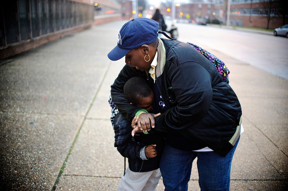 Photo copyright 2009, Matt Roth<br /> Wednesday, February 29, 2012<br /> <br /> City Springs Elementary School first grader Jahmal Harrison, and his mother Tameka Harrison, both currently homeless, wait across the street from his school for the 11 bus to their shelter Wednesday, February 29, 2012. Fans of wrestling, they play around during their wait. Tameka, who can't work due to a facial injury, volunteers at her son's school where poverty is the norm. Ninety-six percent of the student body qualifies for free lunches. Tameka and Jahmal, who suffers from lead poisoning, used to live in one of the close-by housing projects, but have been homeless for the last two months. They're currently staying at Sarah's Hope Shelter in West Baltimore. Tameka thought she was going to be moving into an apartment Friday, under the auspices that both the security deposit and the first month's rent would be waived, but the latter was not. So, they're staying in the Sarah's Hope shelter a little while longer.