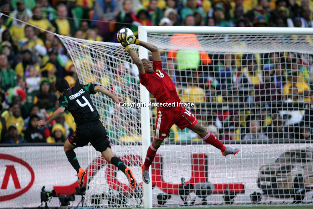 Itumeleng KHUNE beats Rafael MARQUEZ to the cross during the opening match ( match 1) of the FFA World Cup 2010 South Africa held at Soccer City in SOWETO, Johannesburg, South Africa on the 11th June 2010<br /> <br /> Photo by Ron Gaunt/SPORTZPICS