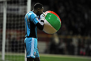 Swindon town goalkeeper Wes Foderingham removes a large beach ball from the pitch before kick off. Capital one cup, 4th round, Swindon Town v Aston Villa at the County Ground in Swindon on Tuesday 30th October 2012. pic by Andrew Orchard, Andrew Orchard sports photography,