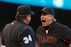 July 23, 2011; San Francisco, CA, USA;  San Francisco Giants bench coach Ron Wotus (23) argues with MLB umpire Sam Holbrook (34) after getting thrown out of the game against the Milwaukee Brewers during the fourth inning at AT&T Park.