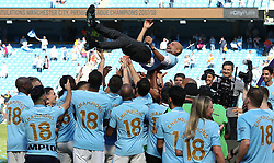 Manchester City manager Pep Guardiola is thrown up into the air by players during the Premier League trophy celebrations after the Premier League match at the Etihad Stadium, Manchester after the Premier League match at the Etihad Stadium, Manchester.