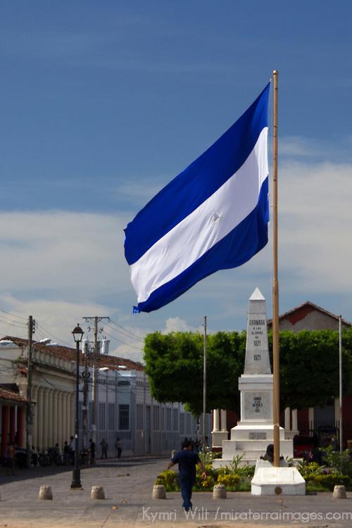 Central America, Nicaragua, Granada. Nicaraguan Flag at Independence Plaza, Granada.