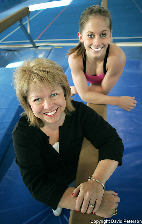 "Being the parent of a  champion international gymnist can be a balancing act, as Teri Johnson is discovering about her gifted daughter, Shawn.  They pose for a photo in 2007 at Chows Gymnastics, in Des Moines, Iowa, where Shawn has honed her skills since the age of six.  Johnson won four medals at the Beijing Olympic Games, including a gold medal in her favorite event, the balance beam.  In response to whether Teri would like for her daughter to continue training for the 2012 Olympics in London she said,  ""If she wants to, I'll be there for her."""
