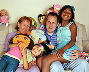 """Jun 17, 2011 - Chicago, Illinois, USA - EXCLUSIVE<br /> <br /> Blind Couple Adopt Blind Children<br /> <br /> RAISING two kids is hard enough – but imagine if both parents are blind…and they adopt two blind children.<br /> Paula and Alan Sprecher did – and say it's the best decision they've ever made!<br /> """"We face challenges all day long – but we always find ways to overcome them,"""" said loving mum Paula, 49, a teacher for the visually impaired.<br /> """"Alan  and I have been legally blind since birth, so we know how to teach our kids survival skills that make them confident and independent young people.<br /> """"All four of us are lucky. We feel blessed!""""<br /> Paula and Alan were married for 21 years before a chance encounter with two nuns collecting money for overseas orphanages led them to Rupa, then seven years old and living in an orphan in Bangalore, India.<br /> """"Adoption officials told us that all the little girl dreamed of was having a mom and dad,"""" said Paula.<br /> """"Her favorite childhood game was to play like she was talking to her mother and father.""""<br /> Despite initial doubts about parenthood – do we have enough to offer a child? – the couple could not resist adopting the little girl who loves dolls, frilly dresses and bangles. That was in 2008.<br /> Then they found Aihua, four years younger, in China. She's a tomboy who loves blocks and puzzles and sleeps with a yellow toy Jeep.<br /> Now they live in a two-story brick house in Chicago where the microwave buttons are marked with Braille, the clocks announce the time and everyone listens for the school bus at 7.15 a.m.<br /> """"We grew up without sight,"""" said Paula. """"It's normal to us. We knew there were kids out there who were probably abandoned because they were blind and we wanted to provide a home for them – children we knew we could help.""""<br /> The Sprechers teach their girls how to ride the bus (listen carefully for each stop), how to identify coins by size and weight (""""This is a dime!"""" Aihua say"""