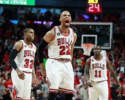 15.05.2011, UNITED CENTER, CHICAGO, USA, NBA, Chicago Bulls vs Miami Heat, im Bild Taj Gibson (C) reacts after scoring against Miami Heat in game 1 of the NBA Eastern Conference Championships at the United Center in Chicago, EXPA Pictures © 2011, PhotoCredit: EXPA/ Newspix/ KAMIL KRZACZYNSKI +++++ ATTENTION - FOR AUSTRIA/ AUT, SLOVENIA/ SLO, SERBIA/ SRB an CROATIA/ CRO, SWISS/ SUI and SWEDEN/ SWE CLIENT ONLY +++++