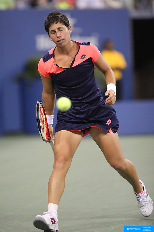 Carla Suarez Navarro, Spain, in action against Serena Williams, USA, during the Women's Singles competition at the US Open. Flushing. New York, USA. 2nd September 2013. Photo Tim Clayton