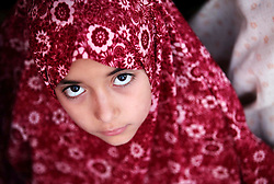17.07.2015, Gaza Stadt, PSE, Fastenmonat Ramadan, im Bild ein Kind // A Palestinian girl poses for a photograph during the Eid al-Fitr prayer, marking the end of the fasting month of Ramadan, in Gaza City's eastern suburb of Al-Shejaiya, Palestine on 2015/07/17. EXPA Pictures © 2015, PhotoCredit: EXPA/ APAimages/ Ashraf Amra<br /> <br /> *****ATTENTION - for AUT, GER, SUI, ITA, POL, CRO, SRB only*****