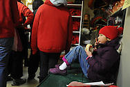 February 13, 2011 - A daughter of one of Gund Kwok member's eats a steamed bun while the group prepares to attend New Year celebrations in Boston's China Town. .