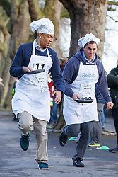 © Licensed to London News Pictures. 28/02/2017. London, UK. Labour's CLIVE LEWIS MP and Conservative's JOHNNY MERCER MP race against Lords and members of media at the annual Rehab Parliamentary Pancake Race outside the Parliament on Shrove Tuesday, 28 February 2017. Photo credit: Tolga Akmen/LNP