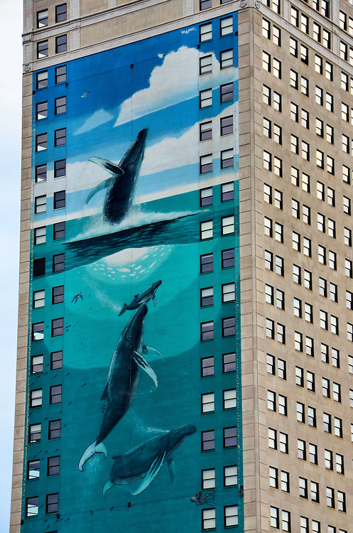 Humpback Whale Mural on Broderick Tower by Wyland in Detroit, Michigan<br /> In 1997, Wyland painted this &ldquo;Whale Tower.&rdquo; The artwork measures 65 feet wide by 180 feet tall on the David Broderick Tower in Detroit, Michigan. The mural was unfortunately covered by an advertisement during the 2006 World Series. However, it is again visible to Detroit&rsquo;s theater patrons and sports fans.