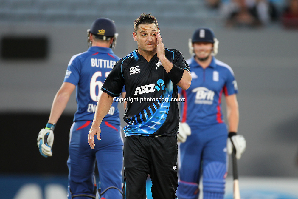Nathan McCullum bowling in the  ANZ T20 Series, NZ V England, Eden Park, 9 February 2013. Photo: Fiona Goodall/photosport.co.nz