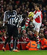 Mathieu Flamini of Arsenal (right) challenges Cheik Ismael Tiote of Newcastle United (left) during the Barclays Premier League match at the Emirates Stadium, London<br /> Picture by David Horn/Focus Images Ltd +44 7545 970036<br /> 13/12/2014