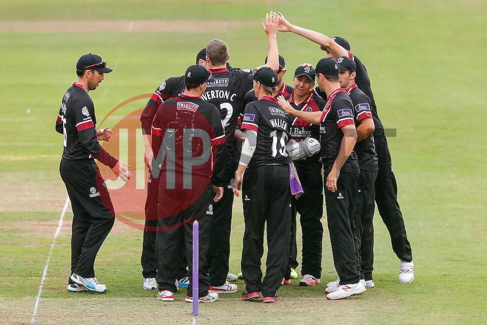 Michael Bates of Somerset (4R) celebrates with bowler Craig Overton and teammates after catching out Wes Durston of Derbyshire for 29 - Mandatory byline: Rogan Thomson/JMP - 07966 386802 - 26/07/2015 - SPORT - CRICKET - Taunton, England - County Ground - Somerset v Derbyshire Falcons -Royal London One-Day Cup.