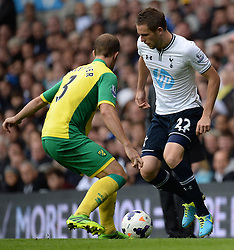 Norwich's Steven Whittaker and Tottenham's Gylfi Sigurosson compete for the ball  - Photo mandatory by-line: Mitchell Gunn/JMP - Tel: Mobile: 07966 386802 14/09/2013 - SPORT - FOOTBALL -  White Hart Lane - London - Tottenham Hotspur v Norwich - Barclays Premier League