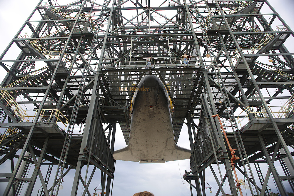 Cape Canaveral, Florida US - The space shuttle Endeavour is suspended in the MDD at the Shuttle Landing Facility waiting to be placed atop the Shuttle Carrier Aircraft, a modified 747, for her final flight to Los Angeles, California.